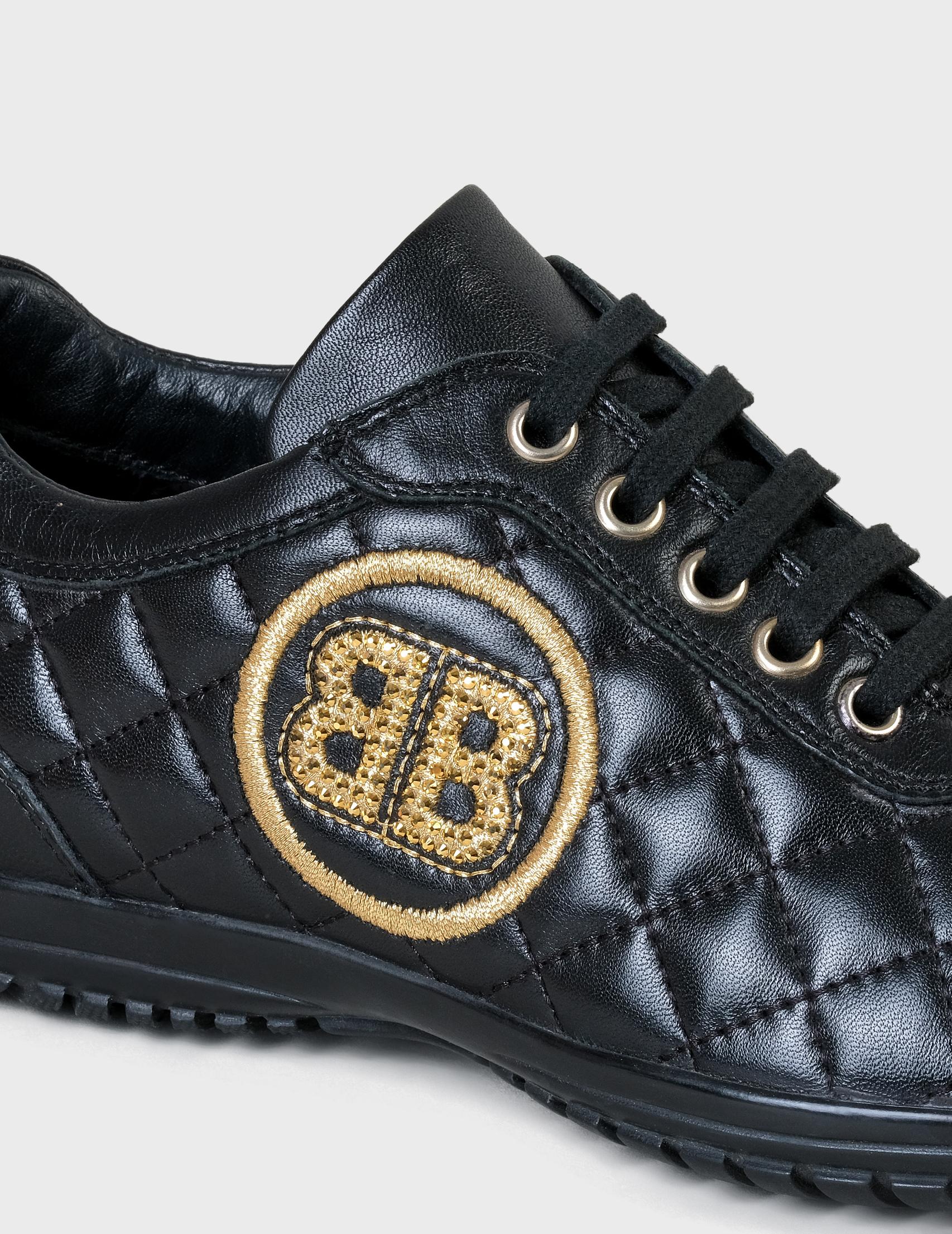 Фото 5 - женские кроссовки  черного цвета